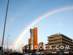 Rainbow Over City Photo Image