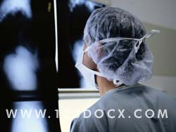 Surgeon Examining Xrays Photo Image